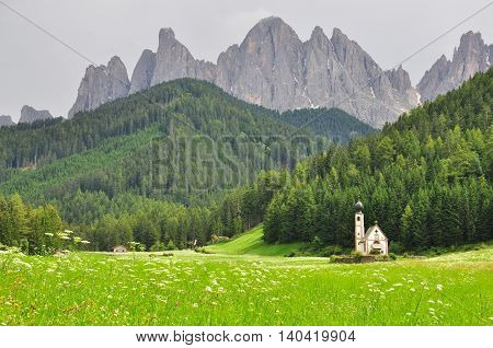 Church and mountains in Trentino Alto Italy