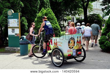 Newport Rhode Island - July 17 2015: Visitors arriving via a pedicab at 1898-1902 Rosecliff Mansion built for Theresa Fair Oelrichs a silver heiress from Nevada
