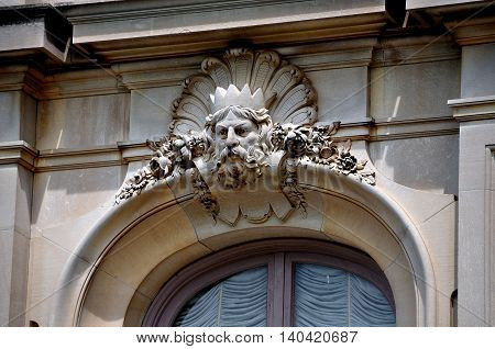 Newport Rhode Island - July 17 2015: Sculpted face of Neptune wearing a crown above a window at French-inspired 1901 The Elms mansion