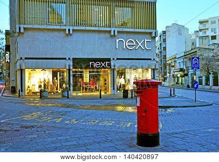 SLIEMA MALTA - MARCH 09: Next flagship store in Sliema town on March 09 2013. Next is a popular british fashion global retail brand.