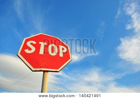 The Stop sign and blue cloudy sky