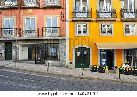 LISBON PORTUGAL - NOVEMBER 24: View of a main street in Baixa district of Lisbon on November 24 2012. Lisbon is a capital and largest city of Portugal.