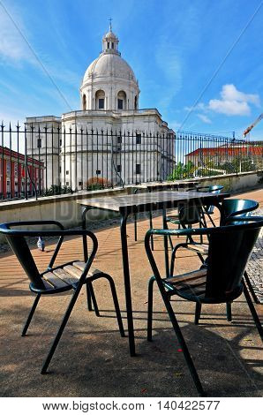 Cafe table and pantheon of Lisbon, Portugal