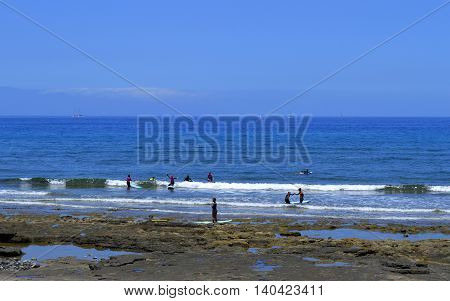 Playa De Las Americas beach Tenerife Canary Islands Spain Europe - June 12 2016 : Surfing on Playa De Las Americas beach