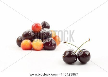 cherries sprinkled with coconut on white background