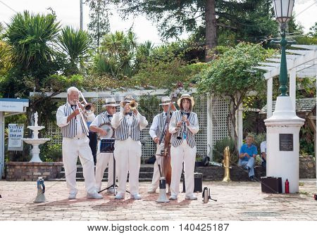 Tauranga, New Zealand - April 1, 2013; Traditional jazz band Twin City Stompers perform in Tauranga Historic Village for jazz festival