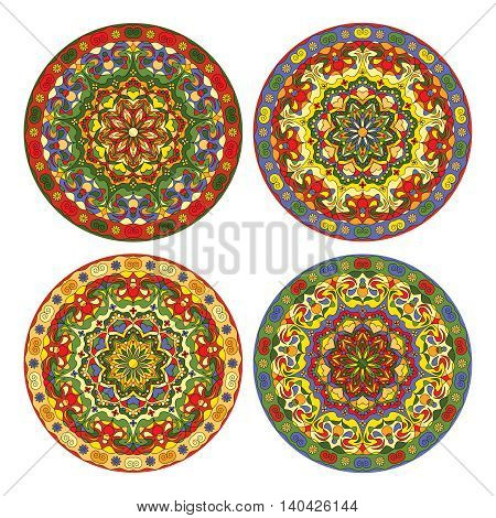 Four bright circular ornaments to dishes, plates and souvenirs. Vector illustration.