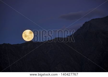 Moon rising over the mountains, New Zealand