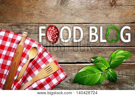 Checkered napkin and cutlery on wooden background. Food blog concept