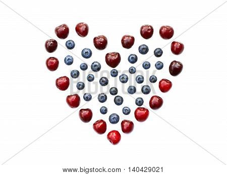 Isolated heart of cherry and blueberry on a white background