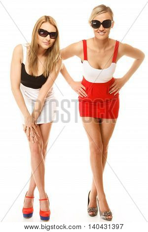 Full length two beautiful sexy crazy women fashion girls in summer clothes sunglasses. Studio portrait isolated on white