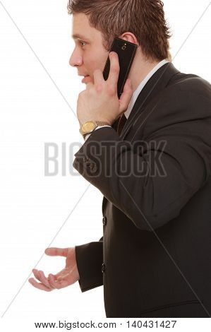 Technology and communication - confused businessman talking on mobile cell phone smartphone worried man using cell phone isolated. Misunderstanding.