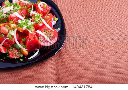 Top View Of The Salad Of Tomatoes, Peppers And Onions