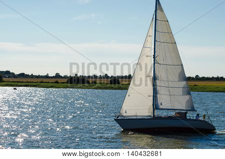 Sailing ship yachts with white sails ocean
