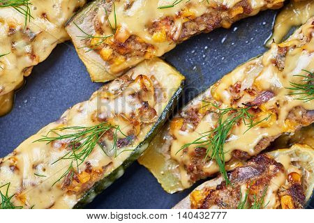Grilled courgettes stuffed with meat and vegetables