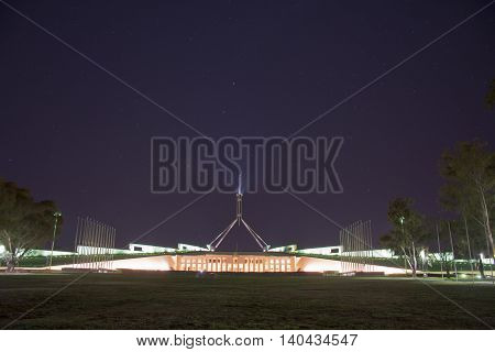 2016 JULY 29: The building of the Australian Parliament lit up at night - unique landmark of Australia