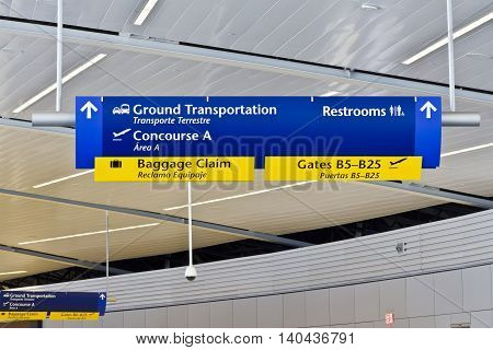 Indianapolis - Circa July 2016: Generic Direction Sign Assisting Travelers in the Airport I