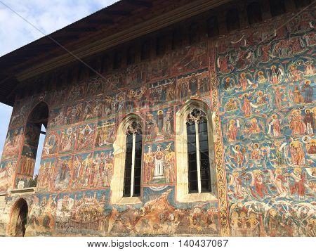 Romania, August 23, 2015, Vatra Moldovitei, North Moldova, Monastery lateral painted wall