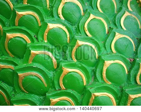Sculpture of green serpent or dragon scales texture background
