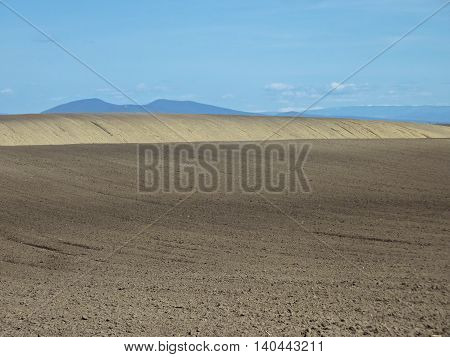Cultivated fields in early spring. Agriculture in central Europe