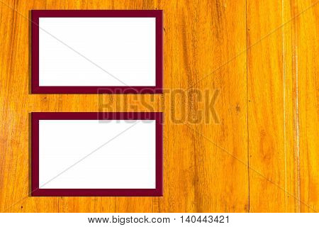 Blank piceture frames on the wooden wall,copy space