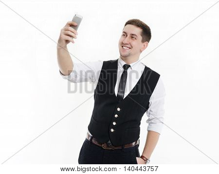 Businessman making selfie photo on your smartphone. Isolated on white background.