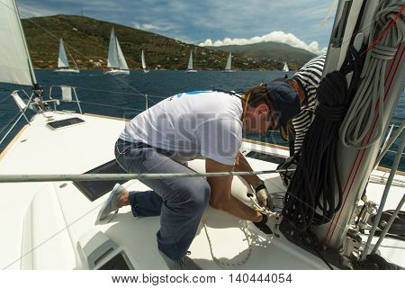 ANDROS, GREECE - APRIL 29, 2014: Unidentified sailors participate in sailing regatta 11th Ellada among Greek island group in the Aegean Sea, in Cyclades and Argo-Saronic Gulf.