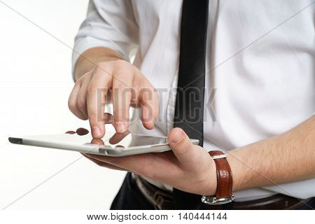 man hands holding a tablet and typing. White background.