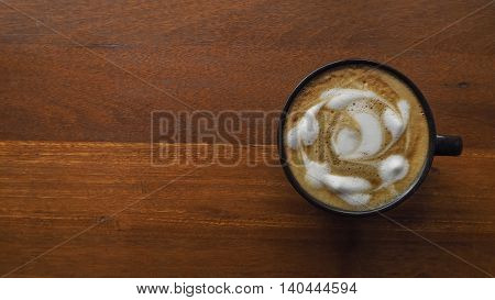 Hot coffee in black cup for wood background.
