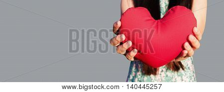 Hands Gently Raise And Hold Red Heart,love And Care