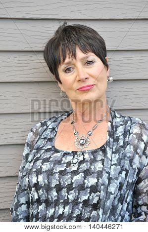 Mature female beauty fashion model  expressions outside.