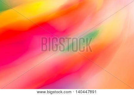 The colorful abstract background with defocused lights