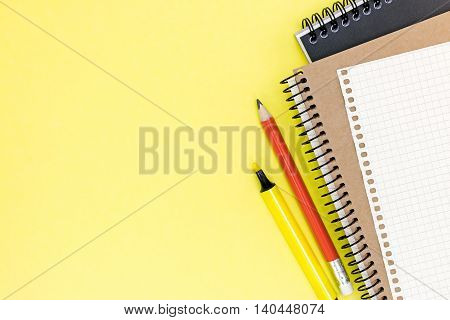 Office Stationary With Two Clean Notebooks And Sheet Of Paper On Yellow