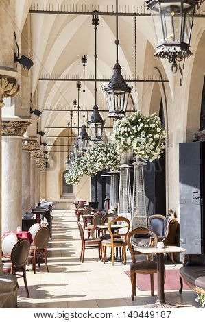 Restaurant under the arches of Cloth Hall ( Sukiennice) Main Market Square Krakow Poland