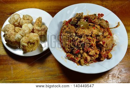 spicy stir-fried pork rib and chicken with lemon leaf