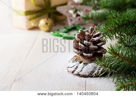 Christmas composition with pinecone and fir-tree Selective focus.