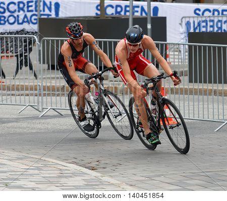 STOCKHOLM SWEDEN - JUL 02 2016: Male triathlete cyclists Andreas Schilling and Xavier Grenier-Talavera in the Men's ITU World Triathlon series event July 02 2016 in Stockholm Sweden