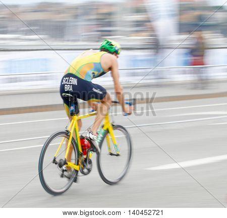 STOCKHOLM SWEDEN - JUL 02 2016: Side view of male triathlete cyclist Diogo Sclebin (BRA) slightly blureed in the Men's ITU World Triathlon series event July 02 2016 in Stockholm Sweden