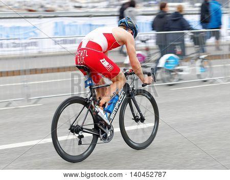 STOCKHOLM SWEDEN - JUL 02 2016: Side view of male triathlete cyclist Lukas Pertl (AUT) in the Men's ITU World Triathlon series event July 02 2016 in Stockholm Sweden
