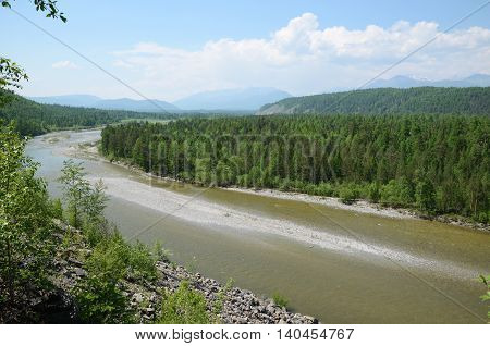 Curved riverbed of Irkut River in its beginning in the Sayan Mountains in sunny day