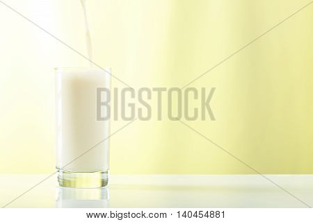 Pouring Milk In Tall Glass
