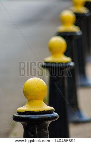 Black And Yellow Metal Barrier Pillars