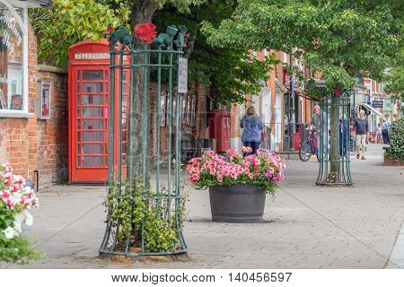 Hartley Wintney/UK. 29th July 2016. The High Street in Hartley Wintney also carries the A30 trunk road through it. The village is within Hart District which for five years in a row has been voted the most desirable place to live in the UK for quality of l