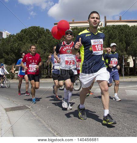 QUARTU S.E., ITALY - April 21, 2013: Fourth marathon of solidarity - Sardinia - athletes who run through the streets of the city,