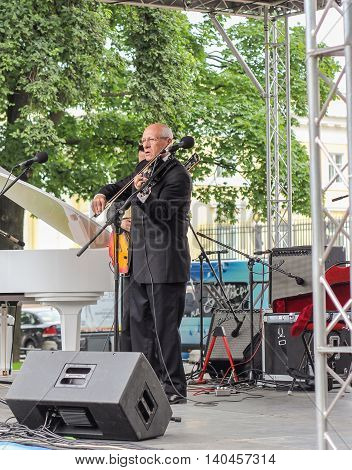 St. Petersburg, Russia - 23 July, Maestro plays the violin, 23 July, 2016. Speech by David Goloschekin with his jazz group on the Arts Square in St. Petersburg.
