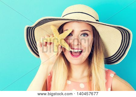 Happy Young Woman Holding A Starfish