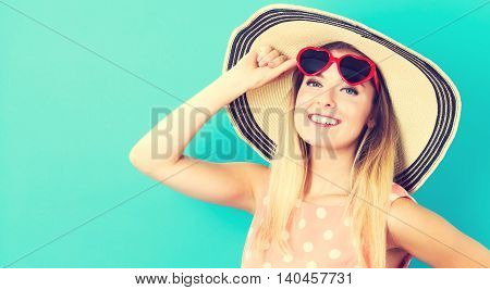 Happy Young Woman Wearing Hat And Sunglasses