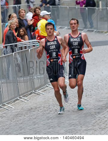 STOCKHOLM - JUL 02 2016: Front view of running triathletes Alistair and Jonathan Brownlee in the Men's ITU World Triathlon series event July 02 2016 in Stockholm Sweden