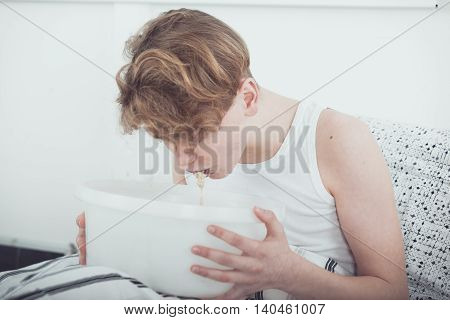 Sick Or Drunk Young Boy Vomiting
