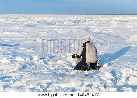 The Photographer Is Photographing With Telephoto Lens